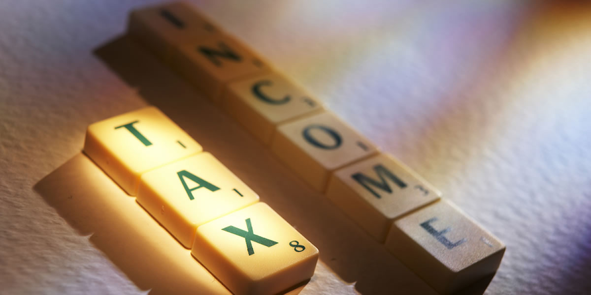 scrabble tiles spelling income tax