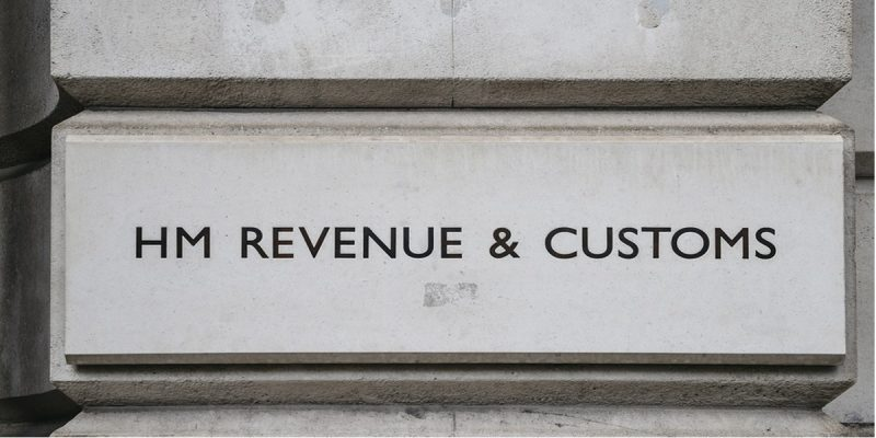 Photo of HMRC sign on their London office. Reads HM Revenue & Customs