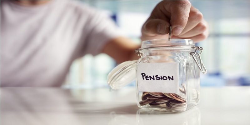 Pension tax shown as a photo of glass jar labelled Pension, with someone adding coins to it