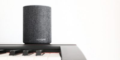 Amazon Echo device sitting on a piano, Alexa and HMRC working together to make tax digital
