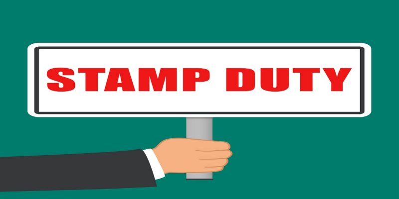 Illustration of stamp duty sign being held by a suited arm