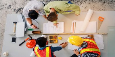 Aerial shot of a construction team discussing project, including CIS subcontractor