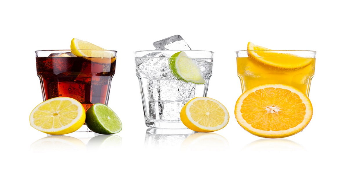 PHoto of three glasses of fizzy drinks that will be subject to the sugar tax