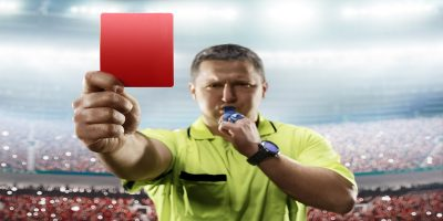 Photo of a football referee showing the red card to HMRC at the conclusion of their tribunal