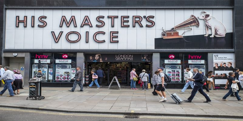Photo of HMV's shop front in London. Shop title reads His Master's Voice with logo of a dog listening to a gramaphone. Illustrating concern over it going into administration and if their vouchers will be honoured.