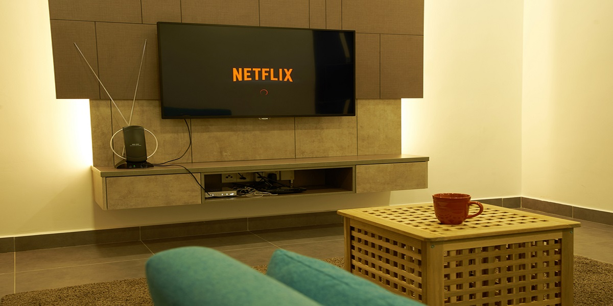 Photo of a living room with Netflix selected on the wall-hung TV. Representing HMRC investigation of their tax situation.