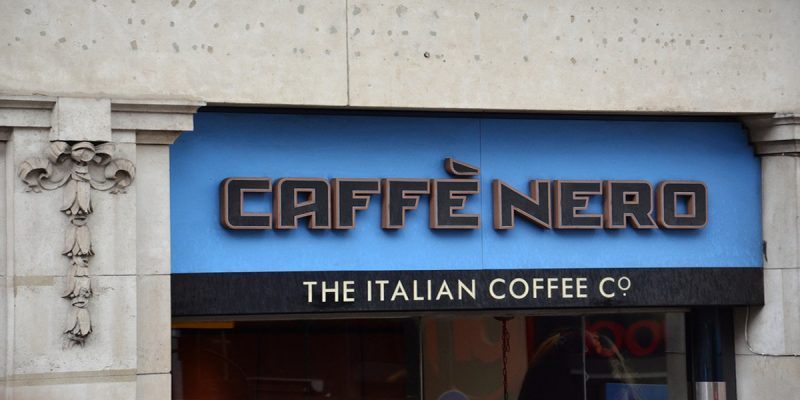 Photo of caffe nero sign on coffee shop. Introducing story that Caffe Nero have not paid corporation tax for 11 years.