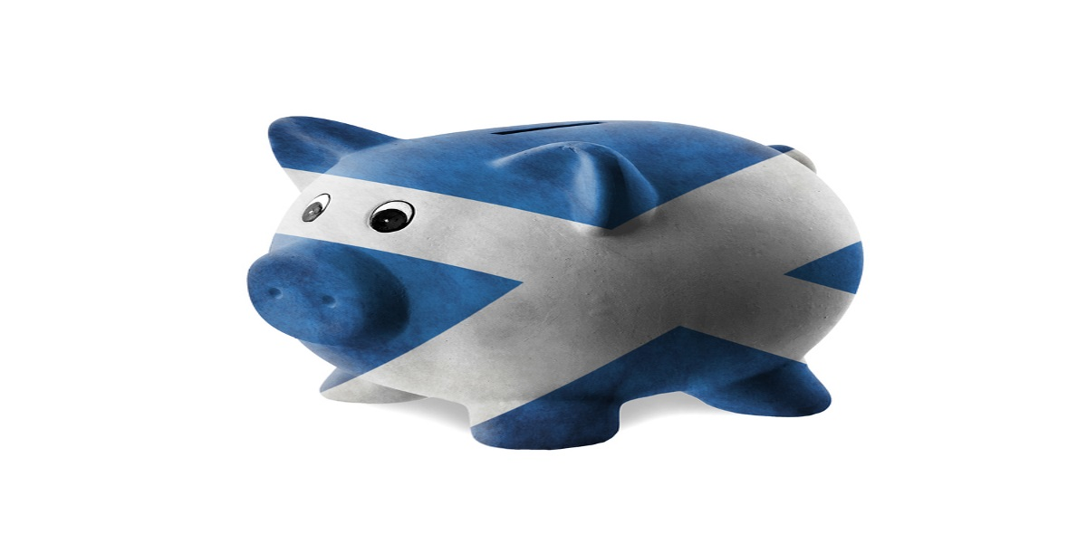 Ceramic piggy bank painted with Scottish flag, representing new Scottish income tax announcements