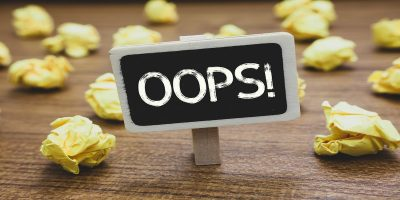 oops sign to show HMRC's late self assessment tax return filing fines mistake
