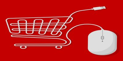Shopping cart created with white computer mouse usb wire on bright red background. Showing effects digital retail is having on UK high streets.