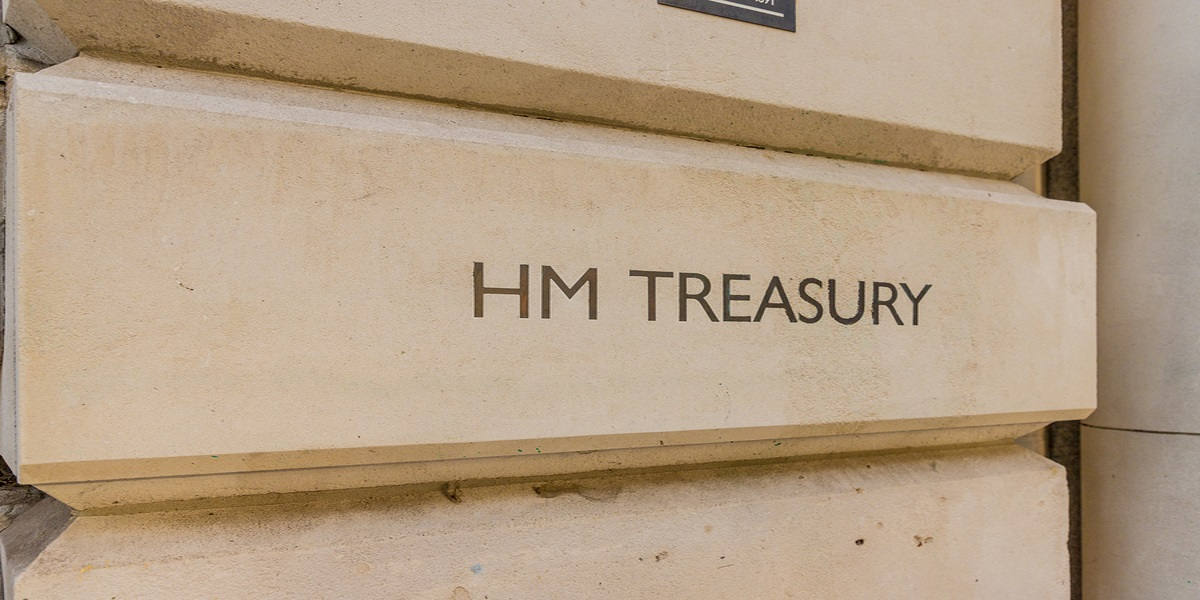 Close up of HM Treasury sign engraved into stonework of London office.
