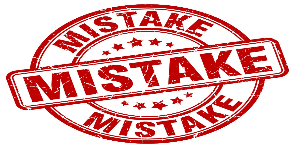 The word mistake as a seal stamp. In red writing on a white background. To show that a mistake has led to Welsh taxpayers being charged Scottish income tax rates.