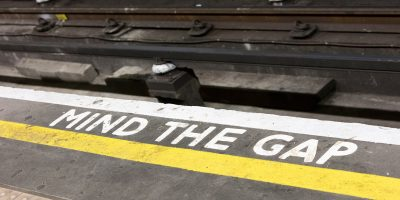 Photo of the Mind the Gap warning sign painted on the London Underground platforms, as illustration of the UK's tax gap.