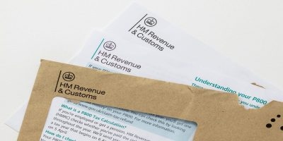 P800 letter from HMRC half way out of its brown, windowed envelope. HMRC logo clearly visible at the top.