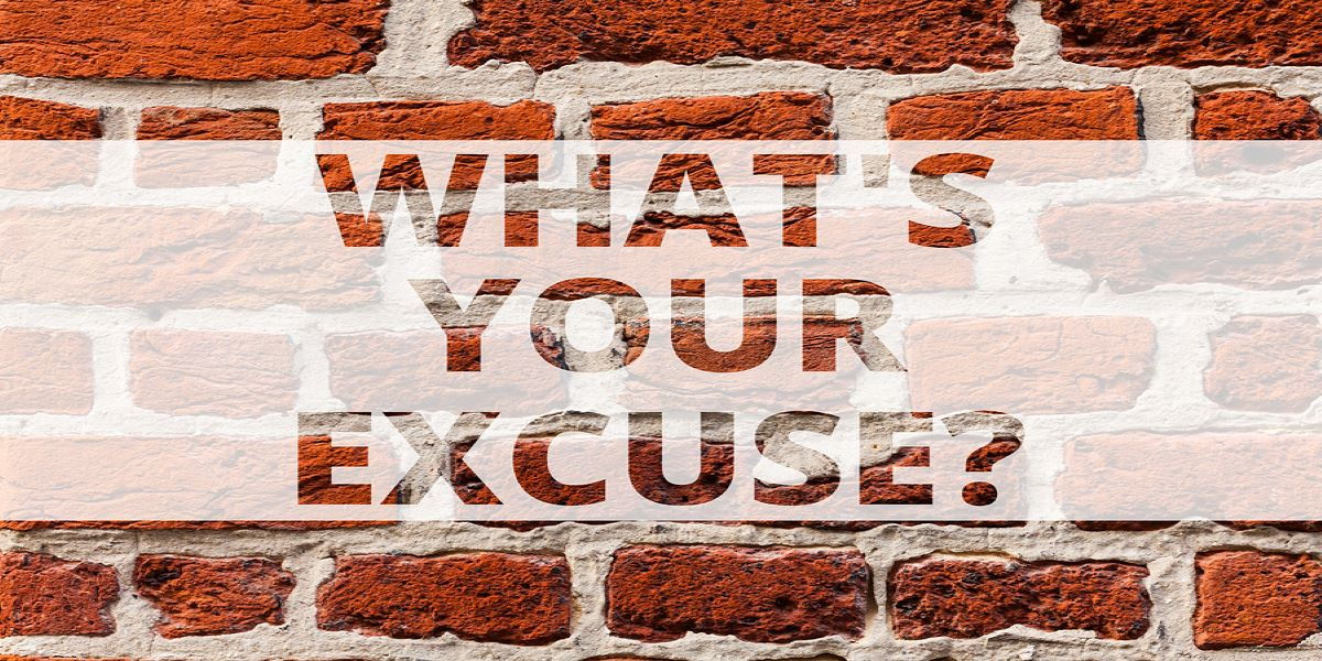 White stencil with the words What's your excuse? in block capitals. Set over a brick wall background.