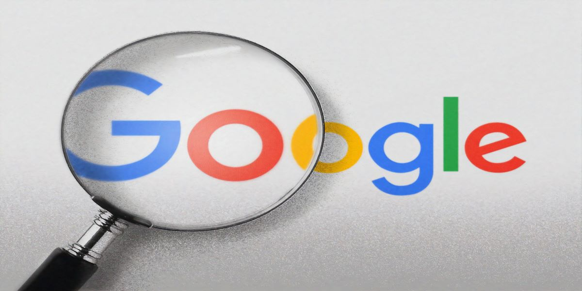 Google logo on a white background. Magnifying glass over the first two letter.