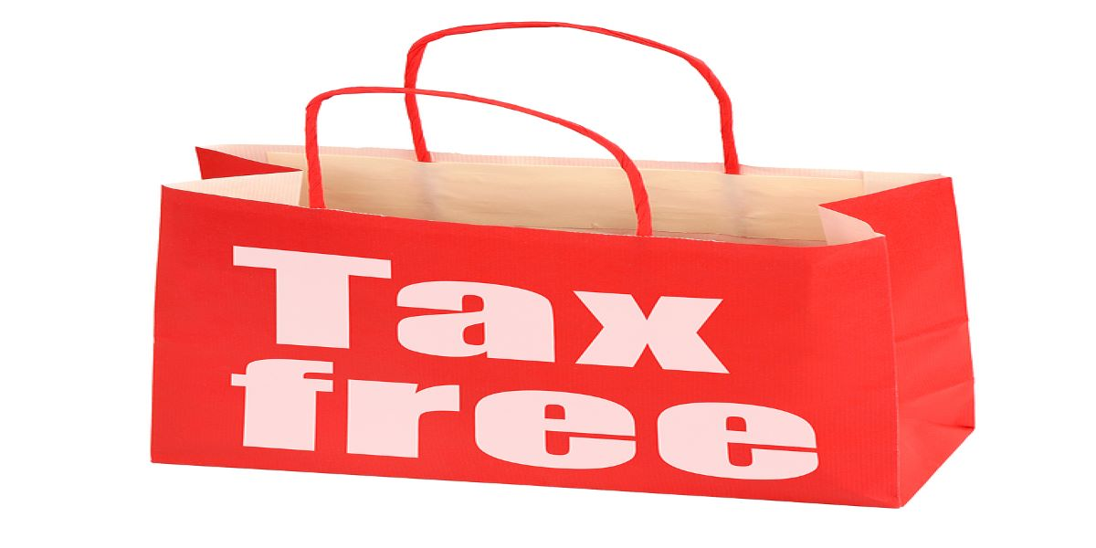 Red paper bag with tax free written on it in white block lettering.