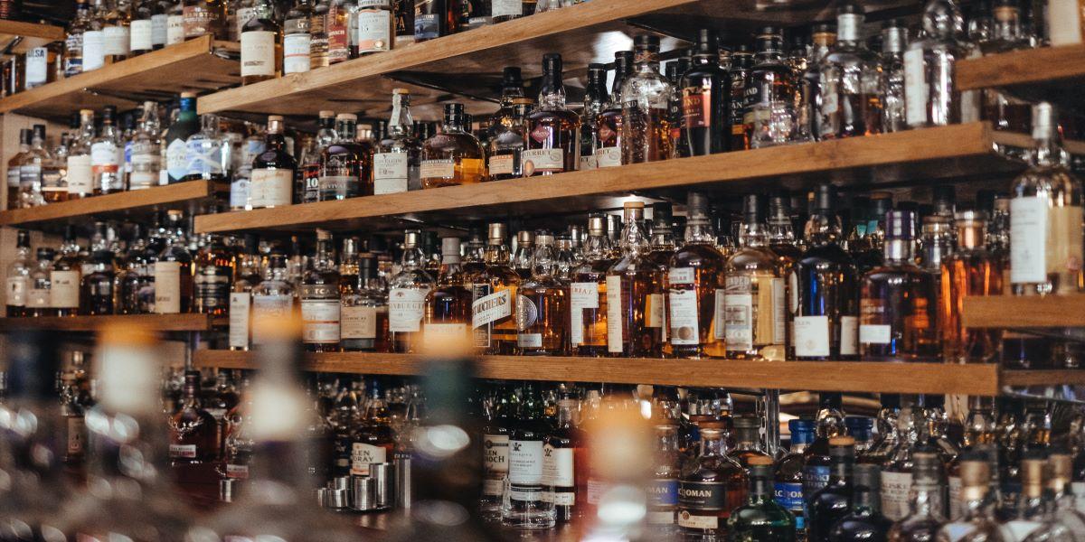 Four shelves of bottles of spirits