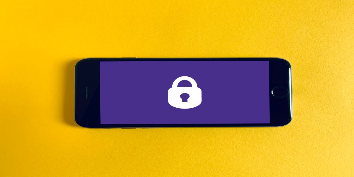 White padlock icon on a purple phone background, on a bright yellow background.