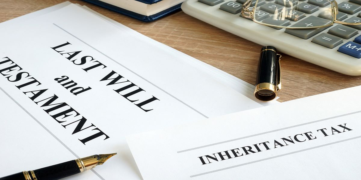2 documents on a desk, Last Will and Testament and Inheritance Tax.