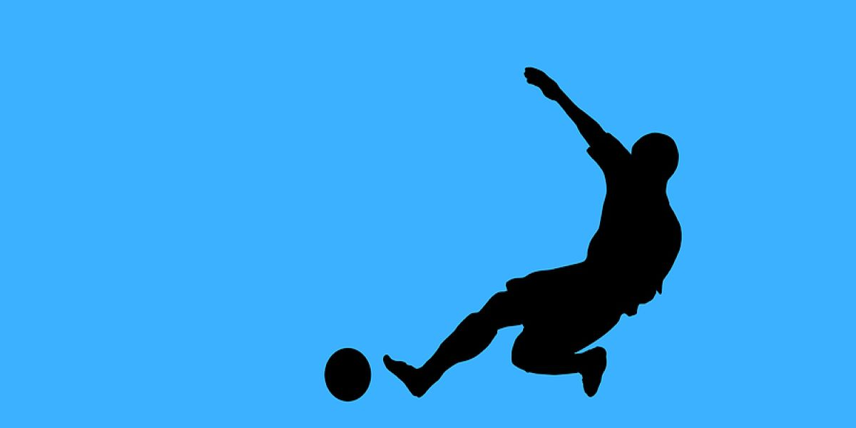 Black silhouette of a man playing football on a blue background.